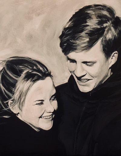 schilderij van lachende jongen en meisje